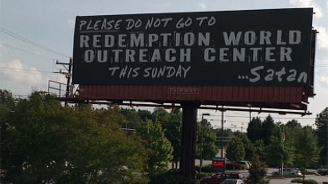 One of Redemption World Outreach Center's billboard's signed by Satan. (May 8, 2012/FOX Carolina)