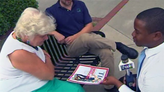 Reporter Greg Funderburg shows the controversial cover to readers in Greenville. (May 10, 2012/FOX Carolina)