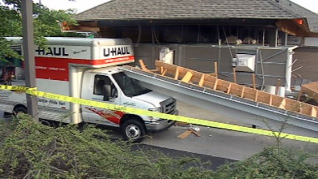 Part of the roof of a Greer bank is strewn about after a U-haul truck hit it. (May 11, 2012/FOX Carolina)
