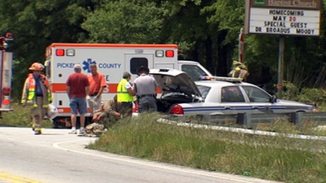Emergency crews mill about the scene of a fatal crash in Pickens County. (May 14, 2012/FOX Carolina)