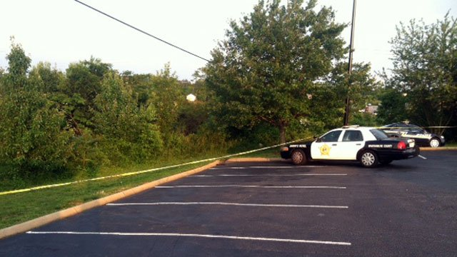 Crime scene tape surrounds a wooded area behind a Duncan restaurant. (May 18, 2012/FOX Carolina)