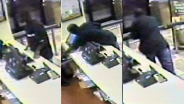 Surveillance footage from the Burger King shows the suspect grab cash from the register then run. (Union Public Safety Dept.)