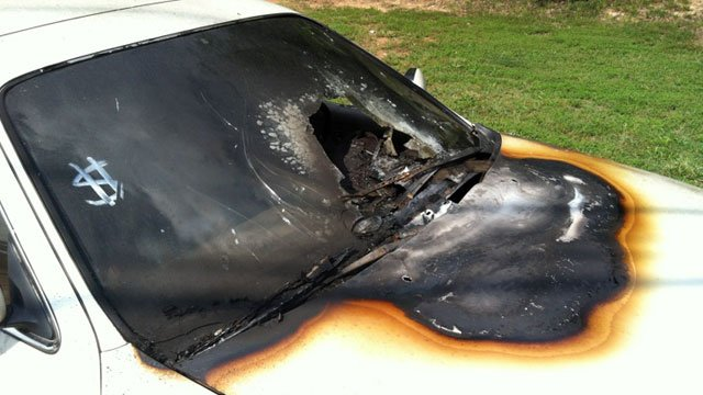 Charred paint and a shattered windshield are just some of the damage caused by the fires. (May 25, 2012/FOX Carolina)