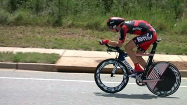 A cyclists participating in the USA Pro Cycling Championship pedals down Millennium Boulevard in Greenville. (File/FOX Carolina)