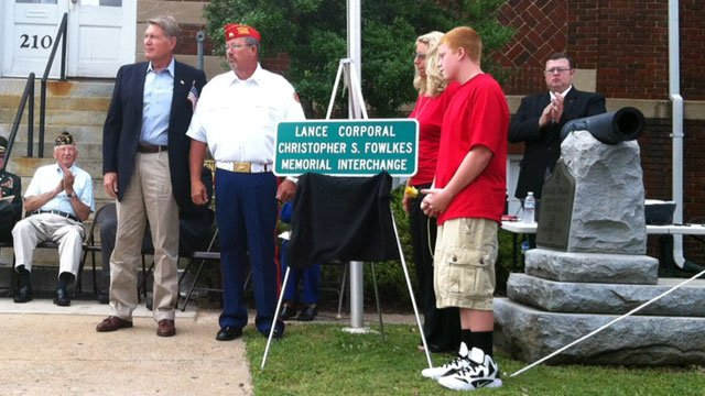 A sign is unveiled naming a Gaffney interchange in honor of a fallen Marine. (May 28, 2012/FOX Carolina)