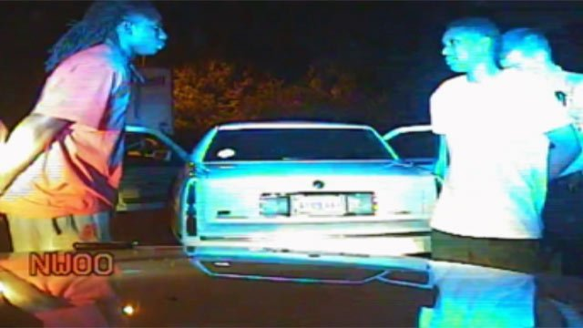 Dash cam video shows Sammy Watkins (left) and Amadou Dia (right) being handcuffed. (May 4, 2012/Clemson Univ. Police Dept.)