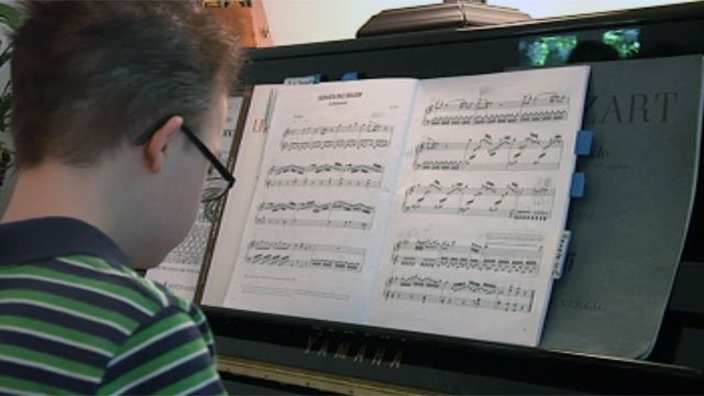 Peter practices playing the piano. (May 31, 2012/FOX Carolina)
