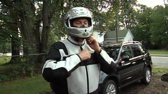 Mike Denise suits up in his protective gear to ride his motorcycle. (June 1, 2012/FOX Carolina)