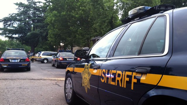 Several cruisers of Greenville County deputies are parked at Fleetwood Manor apartments. (June 5, 2012/FOX Carolina)