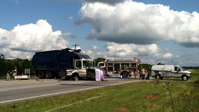 Emergency crews mill about the scene of a fatal crash in southern Greenville County. (June 6, 2012/FOX Carolina)