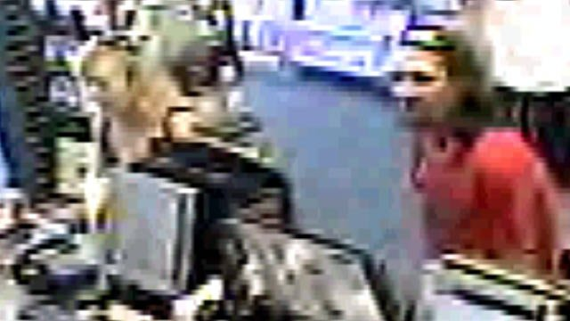 Surveillance footage shows the man and woman deputies say sold stolen property to a Greenville GameStop. (Anderson Co. Sheriff's Office)