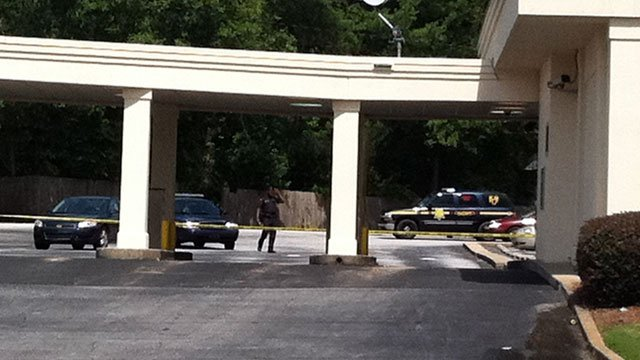 Crime scene tape is strung around a portion of a bank's parking lot after a robbery. (June 7, 2012/FOX Carolina)