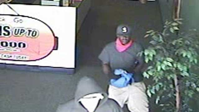 Deputies say these two men robbed an Anderson check-cashing store. (June 8, 2012/Anderson Co. Sheriff's Office)