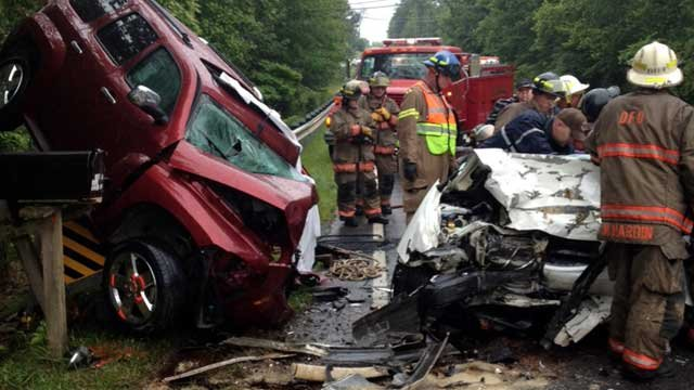 Rescue workers investigate a crash that killed two people in Pickens County. (June 10, 2012/FOX Carolina)