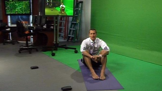 Cody practices yoga live in the studio. (June 11, 2012/FOX Carolina)