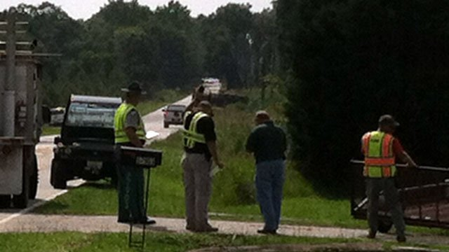Emergency crews look at an overturned truck in the distance. (June 12, 2012/FOX Carolina)