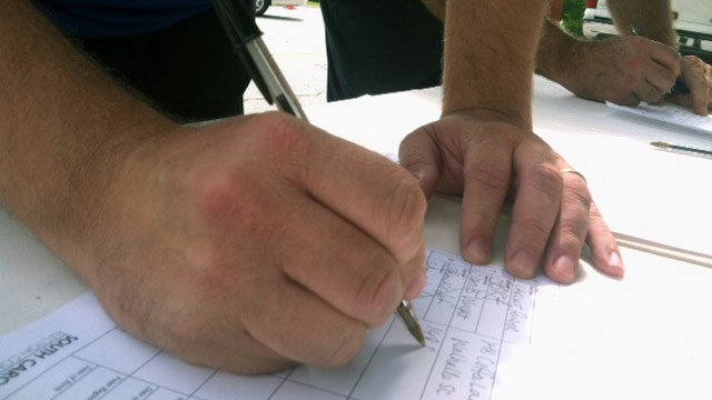 An Oconee Co. voter signs a petition outside of a local polling place. (June 12, 2012/FOX Carolina)