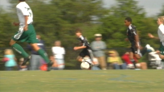 A soccer ball is kicked by players on a field in Greenville County. (File/FOX Carolina)