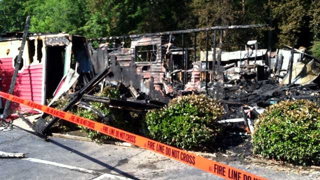 Fire scene tape blocks off the front of the Tall Tales Fish Camp in Cowpens after a fire. (June 17, 2012/FOX Carolina)