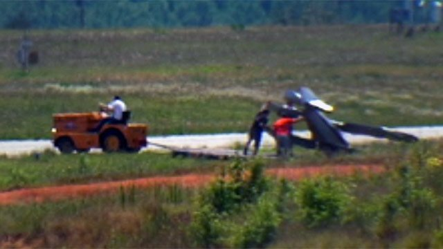 Crews work to tow the damaged plane away. (June 16, 2012/FOX Carolina)