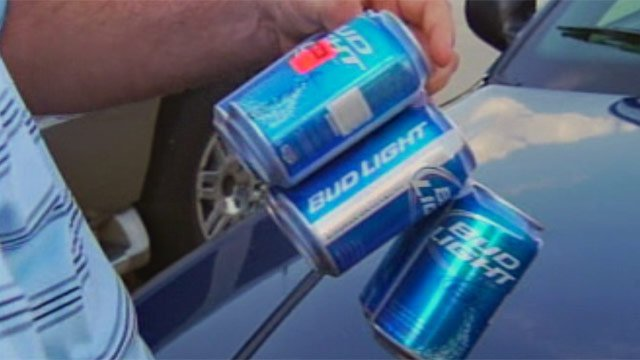 Deputies take a six-pack of beer bought for an underage informant Monday. (June 18, 2012/FOX Carolina)