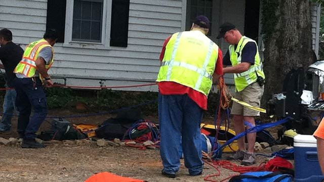 Rescuers at the home where a teen girl fell 30 feet down a well. (June 21, 2012/FOX Carolina)