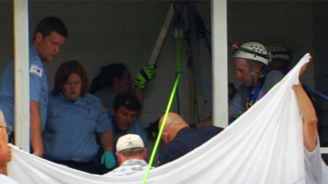 Rescuers pull the teen girl from the well. (June 21, 2012/FOX Carolina)