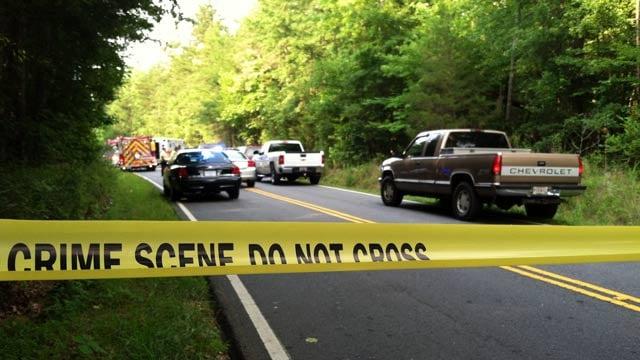 Troopers and emergency crews at the scene of the fatal crash on Slab Bridge Road. (June 23, 2012/FOX Carolina)