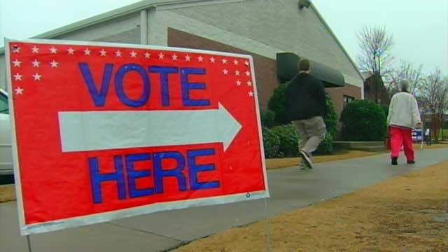 "A ""vote here"" sign outside an Upstate polling place. (File/FOX Carolina)"