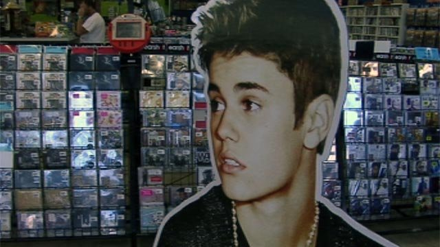 A cardboard cutout of Justin Bieber is on display inside Earshot. (June 26, 2012/FOX Carolina)