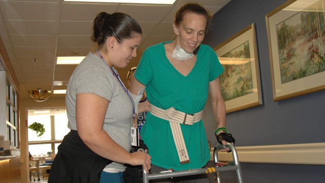 Lana Kuykendall walks during therapy. (Greenville Hospital System)