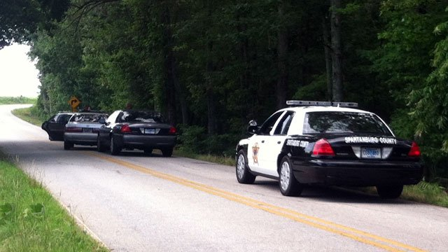 A Spartanburg County deputy's cruiser blocks off part of Green Pond Road near Woodruff after a chase. (July 4, 2012/FOX Carolina)