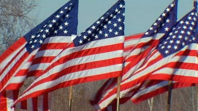American flags wave at a ceremony in Anderson County. (File/FOX Carolina)