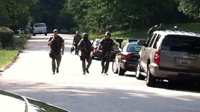 Members of the Greenville County SWAT team walk down a Piedmont street. (July 9, 2012/FOX Carolina)