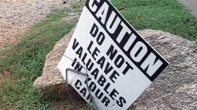 Signs warn people of thefts along the Swamp Rabbit Trail. (July 10, 2012/FOX Carolina)