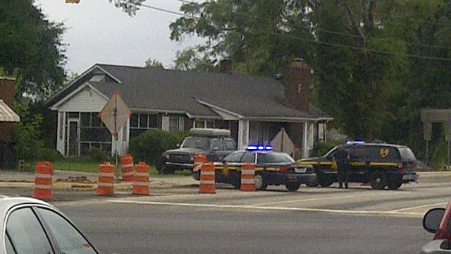 Deputies surround a home near White Horse Road during a standoff. (July 12, 2012/iWitness Jennifer Colburn)