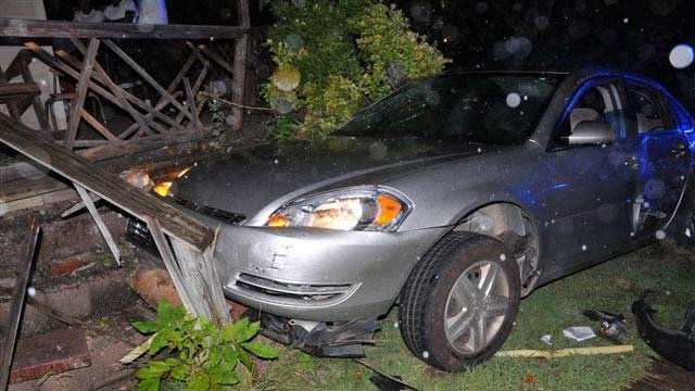 The suspect's car crashed into a Farley Avenue home. (July 12, 2012/Spartanburg Public Safety Dept.)