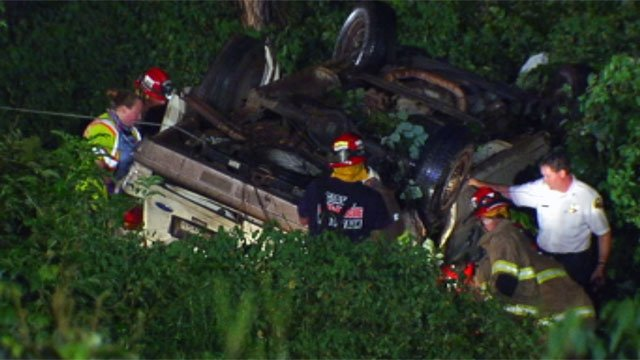 Emergency crews work to rescue scouts from the van that crashed in a creek off of Callahan Mountain Road. (July 13, 2012/FOX Carolina)