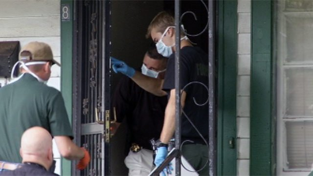 Investigators at a Greenville woman's home after she was found dead Sunday. (July 15, 2012/FOX Carolina)
