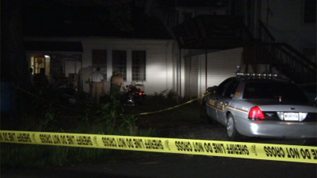 Deputies at the Iva home after a deadly home invasion. (July 15, 2012/FOX Carolina)
