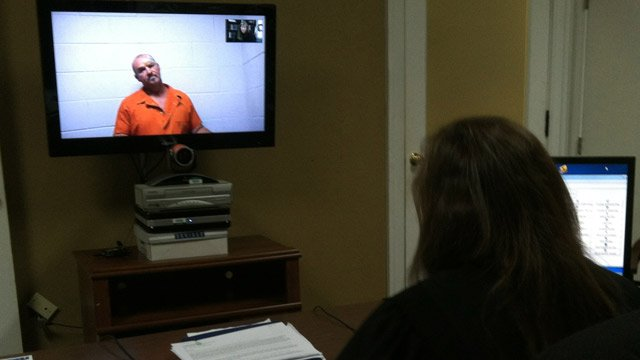Robert Frost appears on camera before a magistrate judge where he was denied bond. (July 17, 2012/FOX Carolina)