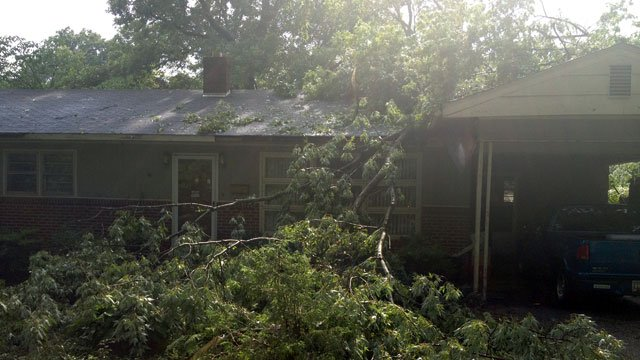 Tree limbs blanket the front yard of a Spartanburg home after a storm moved through the area. (July 18, 2012/FOX Carolina)