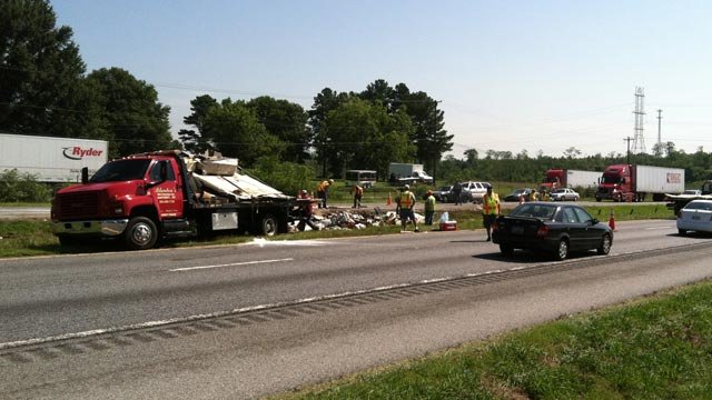 Crews clean up debris along I-85 after a tractor trailer crash scattered cargo across the median. (July 23, 2012/FOX Carolina)