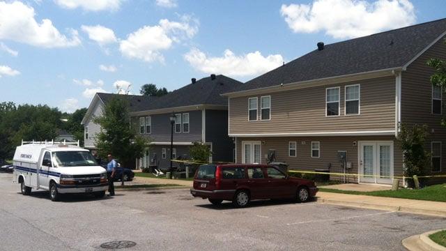 Investigators at the Spartanburg residence where a man was shot. (July 23, 2012/FOX Carolina)