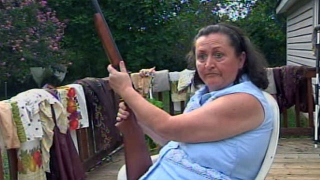 Peggy Davis sits on her porch, armed, to ward off potential burglars. (July 23, 2012/FOX Carolina)