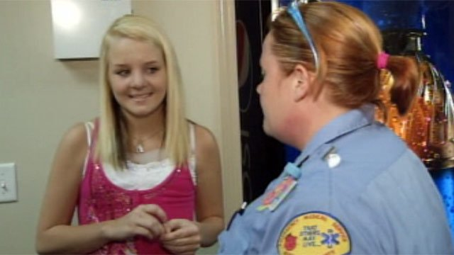 Alyson Myers talks with one of the paramedics who helped rescue her from a well in June. (July 23, 2012/FOX Carolina)