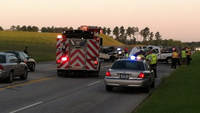 Emergency crews work to clear a crash along Highway 101 near the airport. (July 24, 2012/FOX Carolina)