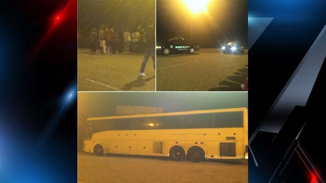 Photos of the broken down bus and passengers milling about along I-85. (Courtesy T. Laney)