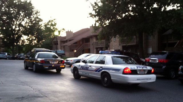 Police search the Haywood Pointe Apartments after a shooting at a nearby park. (July 26, 2012/FOX Carolina)