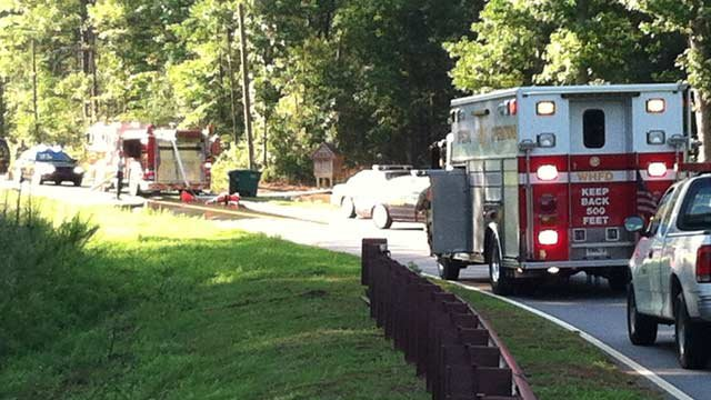 Firefighters and deputies at a Riley Smith Dr. home that caught fire. (July 27, 2012/FOX Carolina)